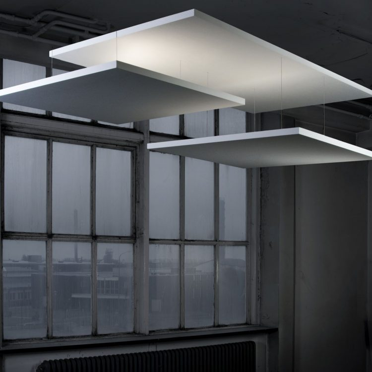 Three floating acoustic ceilings in front of an industrial looking window