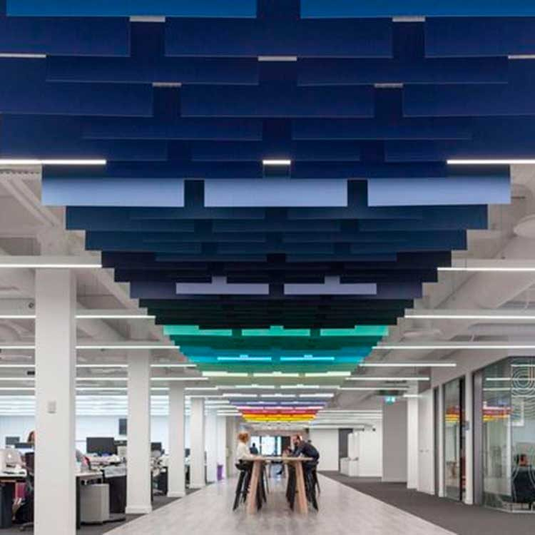 Beautiful and colourful suspended ceilings stretching down office hallway.