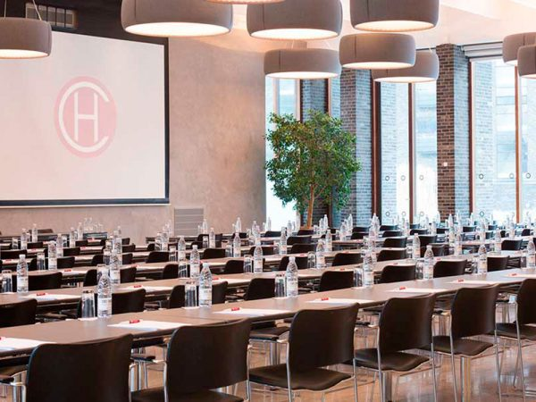 Conference hall at Charlottehaven in Denmark. Acoustic panels are placed in ceiling and under tables